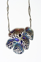 Safira Blom, Self Proliferating Patterns: Organic Neckpiece, 2012 29 x 10 x 1 cm Titanium, 925 silver: hydraulic pressed, hand pierced, torch coloured